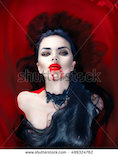 stock-photo-beauty-halloween-sexy-vampire-woman-with-dripping-blood-on-her-mouth-lying-in-a-bath-full-of-blood-499324762